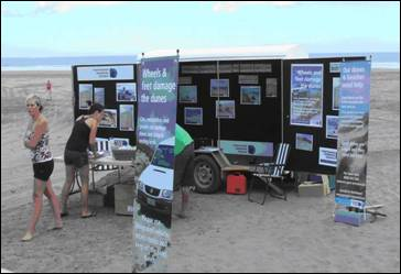 Vehicles on beaches display at Ruakaka beach.